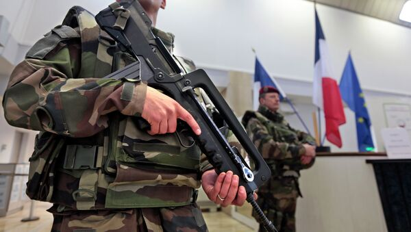 French soldier stands guard inside the Prefecture as part of the highest level of Vigipirate security plan in Nice February 9, 2015. - Sputnik France