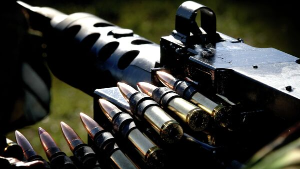 Pictured here is a .50 calibre machine gun at the Commando Training Centre Royal Marines (CTCRM) Lulworth Camp during a training session. - Sputnik France