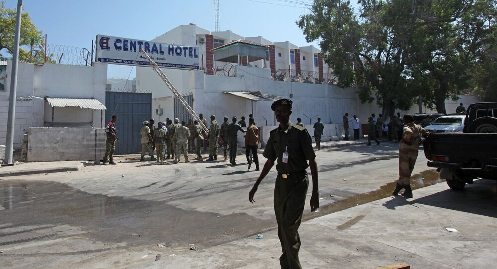 Somali security forces gather outside the scene of a twin bombing attack on a hotel in the capital Mogadishu, Somalia Friday, Feb. 20, 2015.