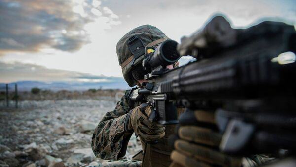 Lance Cpl. Trent Martin aims in on a target during a combined arms exercise aboard Marine Corps Air Ground Combat Center, Twentynine Palms, Calif., Dec. 12, 2014 - Sputnik France