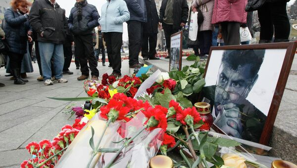 Photos, flowers and candles are left in memory of Boris Nemtsov, who was recently murdered in Moscow, in Independence Square in Kiev, February 28, 2015. - Sputnik France