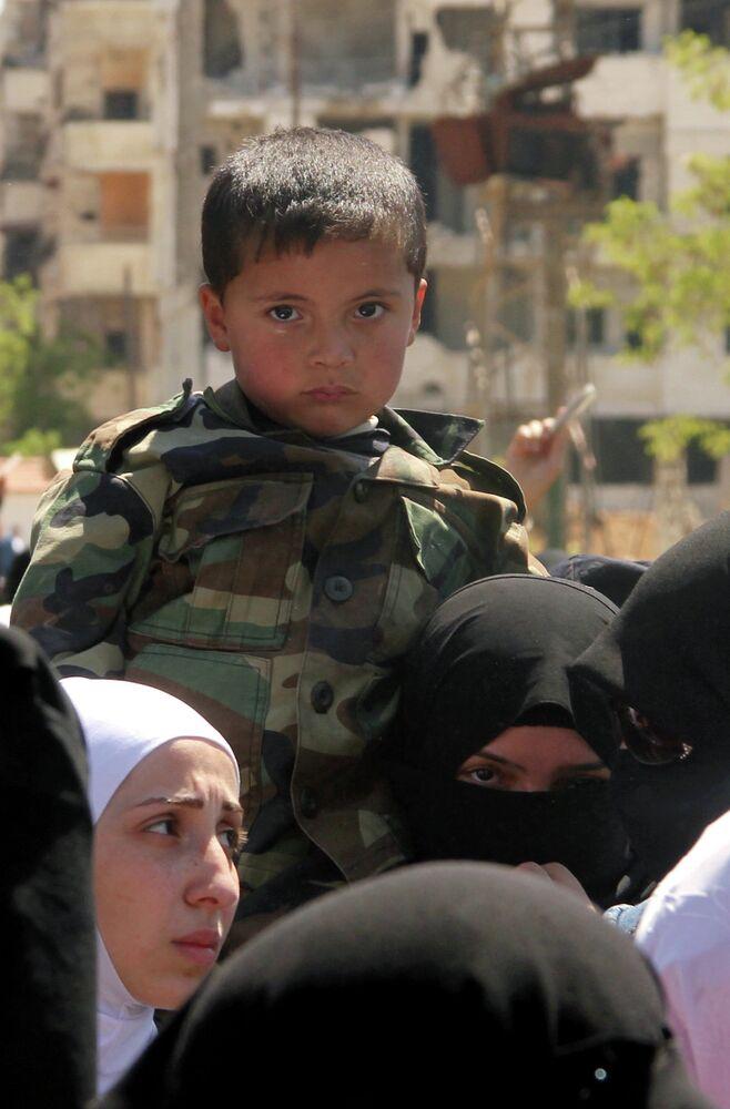 Fuite de réfugiés palestiniens au camp de Yarmouk
