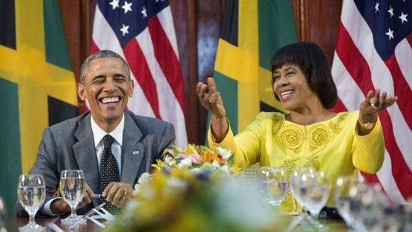 President Barack Obama smiles as he reacts to comments made by Jamaican Prime Minister Portia Simpson-Miller - Sputnik France