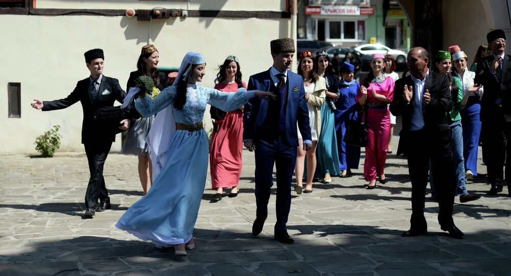 Crimean Tatars perform ethnic dances during a wedding at the Khansarai Khans' Palace, part of the Bakhchisarai Historical Cultural Reserve in the southern Crimea