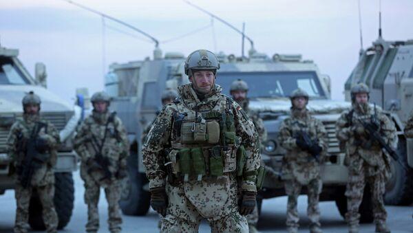 German soldiers stand guard during the NATO Secretary-General Jens Stoltenberg's first visit - Sputnik France