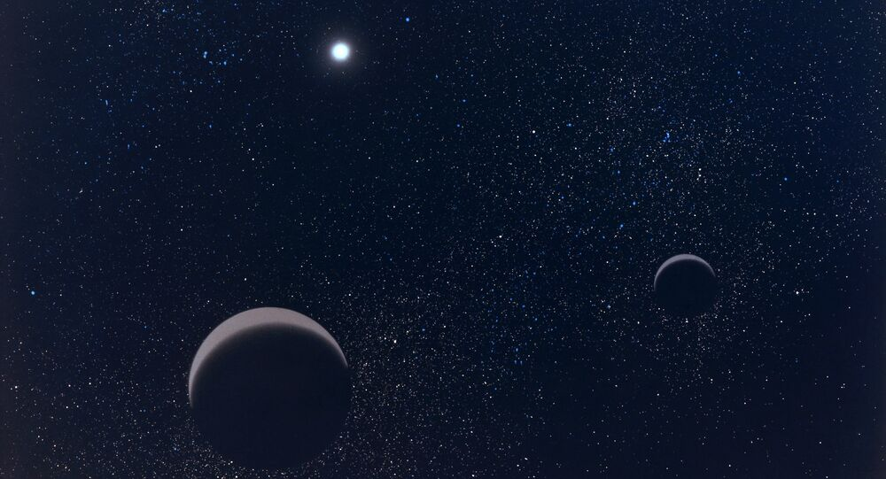 Pluton et son plus grand satellite Charon