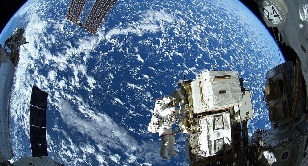 Spacewalker Astronaut Reid Wiseman of NASA outside the International Space Station