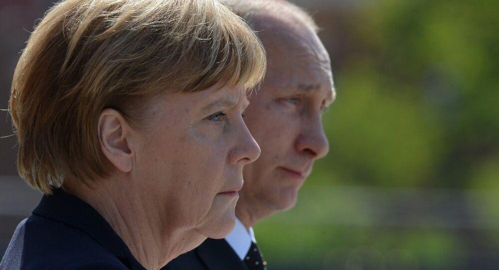 Le président russe Vladimir Poutine et la chancelière allemande Angela Merkel