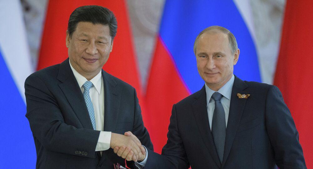Les présidents russe et chinois, Vladimir Poutine et Xi Jinping