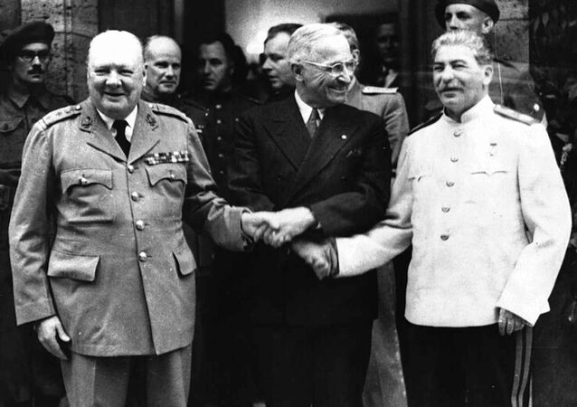 The handshake between Winston Churchill, left, Harry S. Truman and Josef Stalin, right infront of Churchill`s residence in Potsdam/Germany