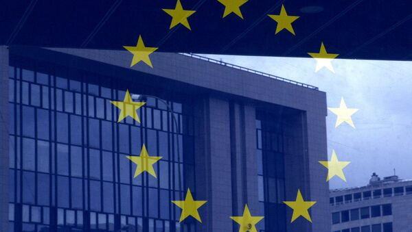 European Council building is reflected in a photograph of the EU flag on the wall of the European Council building, in Brussels - Sputnik France