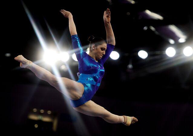 Алия Мустафина (Россия) во время выступления в индивидуальном многоборье на  I Европейских играх в Баку