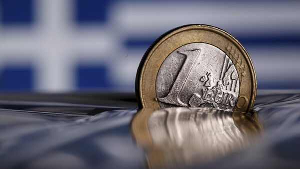 A one Euro coin is seen in this file photo illustration taken in Rome, Italy July 9, 2015 - Sputnik France