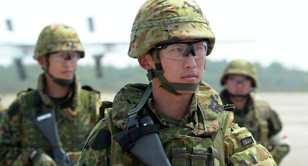 Japanese soldiers stand guard during a Non-Combatant Evacuation/Transportation of Japanese Nationals Overseas exercise as part of the annual combined military exercises coined Cobra Gold 2015