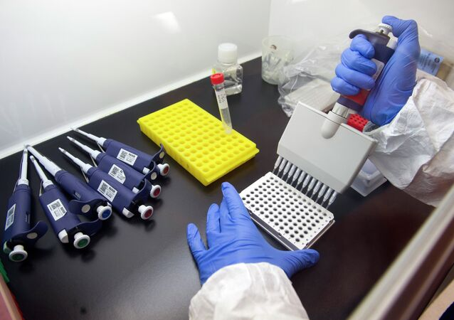 Alberto Cagigi, Ph.D, is beginning the multi-step process of identifying antibodies against Ebola in samples from vaccinated volunteers. at the Vaccine Research Center at the National Institutes of Health in Bethesda, Md., Wednesday, Feb. 4, 2015