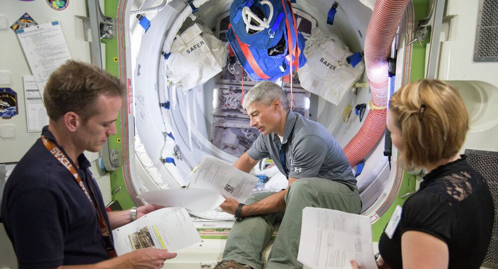 Expedition 51/52 crew member Mark Vande Hei during ISS Joint AL Hardware training with instructors Michael Dino, Eryn Beisner.