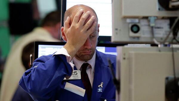 Specialist Meric Greenbaum works at his post on the floor of the New York Stock Exchange, Wednesday, Aug. 12, 2015 - Sputnik France