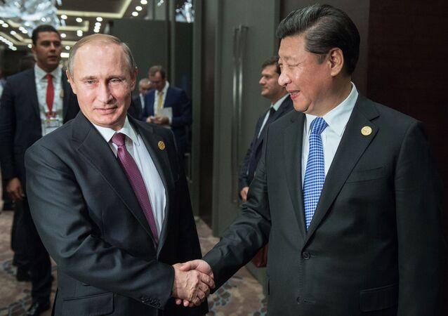 MM. Poutine et Jinping