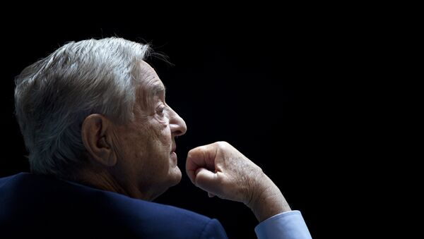 George Soros, Chairman of Soros Fund Management, listens during a seminar titled Charting A New Growth Path for the Euro Zone at the annual International Monetary Fund and World Bank meetings September 24, 2011 in Washington, DC. - Sputnik France
