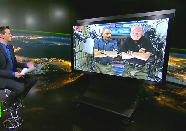 Mikhaïl Kornienko et Scott Kelly, actuellement en mission à bord de la Station spatiale internationale (ISS)