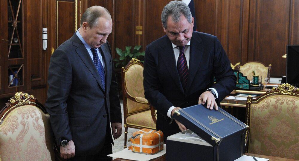 Poutine sur le point d'ouvrir l'enregistreur du Su-24