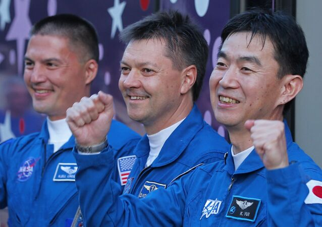 Le cosmonaute russe Oleg Kononenko et les astronautes américain Kjell Norwood Lindgren et japonais Kimiya Yui