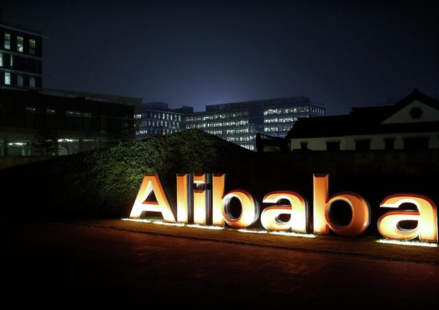 The logo of Alibaba Group is seen inside the company's headquarters in Hangzhou, Zhejiang province early in this November 11, 2014 file photo.