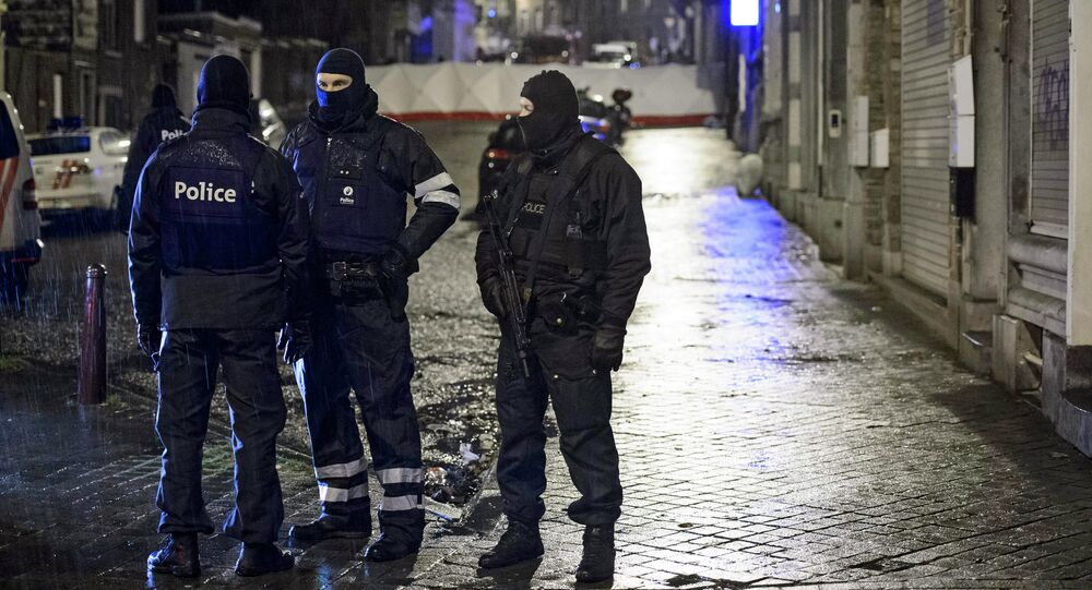 Belgian special forces police block a street in central Verviers, a town between Liege and the German border, in the east of Belgium January 15, 2015.