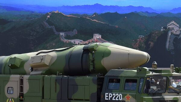 A military vehicle carries DF-21D missile past a display screen featuring an image of the Great Wall of China at Tiananmen Square in Beijing on September 3, 2015 - Sputnik France