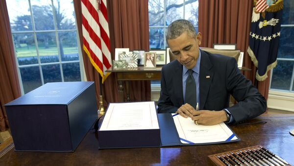 Le président Barack Obama signe le projet de loi budgétaire dans le Bureau ovale de la Maison Blanche - Sputnik France
