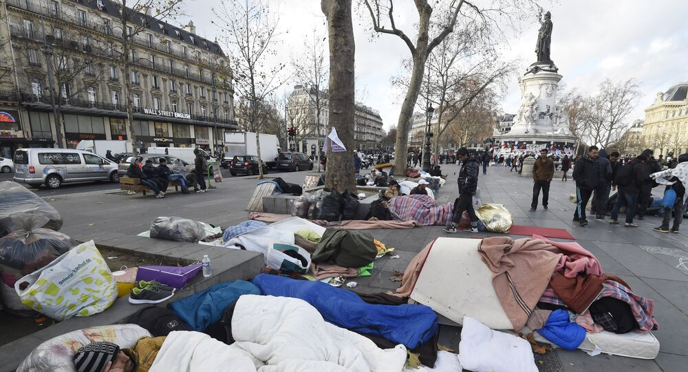 Migrants and refugees understood to be from Afghanistan camp at the place de la Republique in Paris on December 21, 2015.