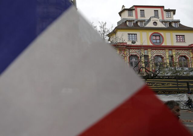 A French flag is seen in front of the Bataclan concert hall to pay tribute to the victims of the series of deadly attacks on Friday, in Paris, France, November 17, 2015.