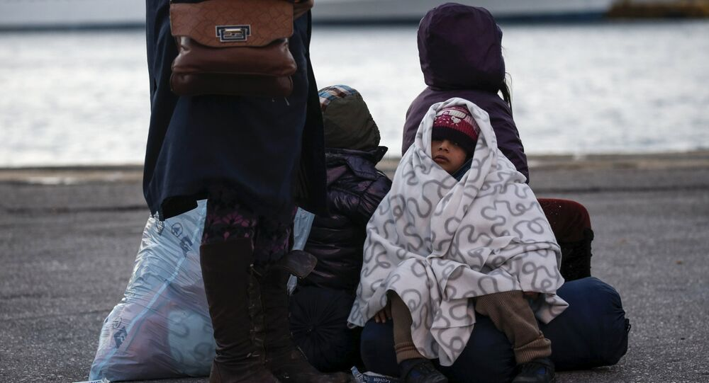 A migrant girl covered with a blanket