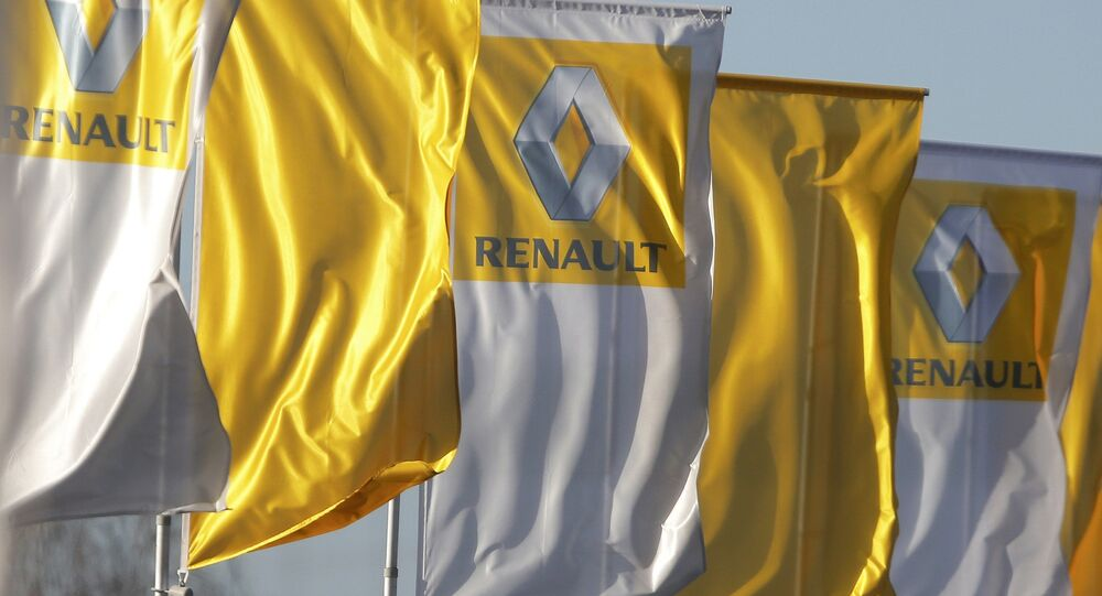 The logo of French car manufacturer Renault is seen on flags in front of a dealership in Strasbourg
