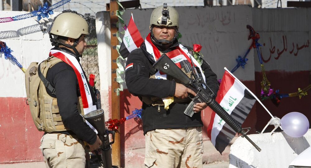 Iraqi soldiers stand guard at a checkpoint  in Baghdad