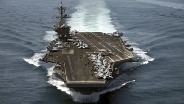 The aircraft carrier USS Theodore Roosevelt (CVN 71) operates in the Arabian Sea conducting maritime security operations in this U.S. April 21, 2015. - Sputnik France