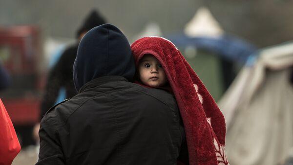 Des migrants dans le camps de Grande-Synthe, prés de Dunkerque le 20 janvier 2016, - Sputnik France