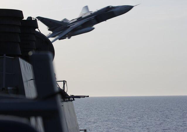 Deux bombardiers russes survolent un navire américain