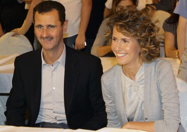 Syrian President Bashar Assad and his wife Asma (File)