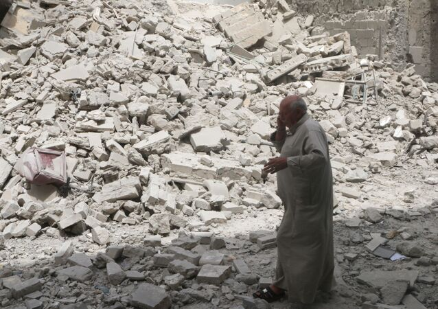 A man walks past the rubble of damaged buildings after an airstrike in the rebel held area of Aleppo's Baedeen district, Syria, May 3, 2016