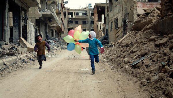 Des enfants dans les rues de Damas - Sputnik France