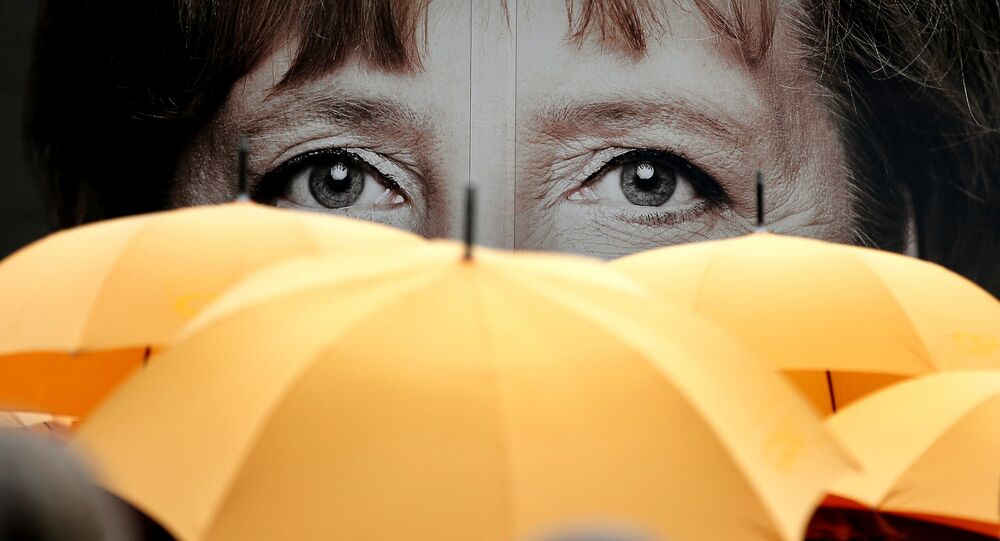 Les Allemands disent en avoir assez de Merkel