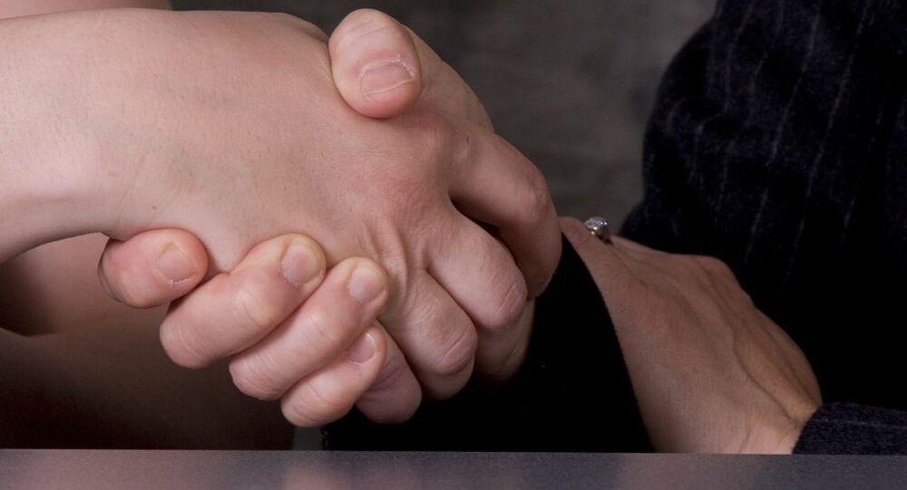 Poignée de main. Image d'illustration
