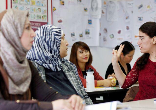Migrants dans un centre de communication interculturelle à Berlin