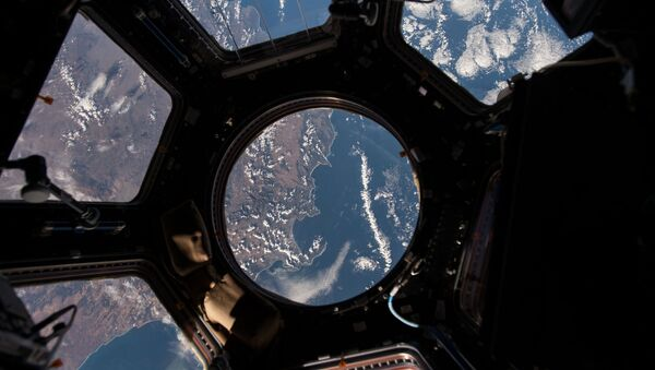 NASA astronaut Scott Kelly on the International Space Station took this Earth observation photo in the stations cupola that provides a 360 degree view. He tweeted this image with the comment: The view out my window. - Sputnik France
