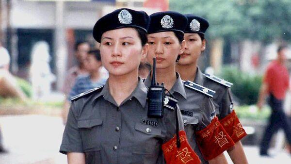 Patrouille féminine en Chine. Image d'illustration - Sputnik France