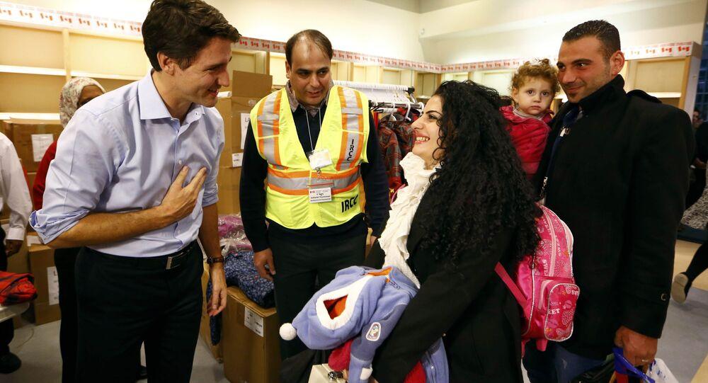 Réfugiés arrivent au Canada. Archive photo