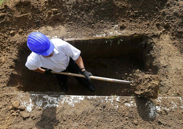 A gravedigger takes part in the first Hungarian grave digging championship in Debrecen, Hungary, June 3, 2016