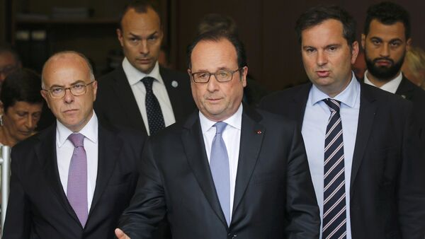 French President Francois Hollande (C), Interior Minister Bernard Cazeneuve (L) and French Interior Ministry spokesman Pierre-Henry Brandet (R) leave the city hall after two assailants had taken five people hostage in the church at Saint-Etienne-du -Rouvray near Rouen in Normandy, France, July 26, 2016. - Sputnik France