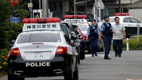 Police officers investigate near a facility for the disabled, where a deadly attack by a knife-wielding man took place, in Sagamihara, Kanagawa prefecture, Japan, July 26, 2016. - Sputnik France